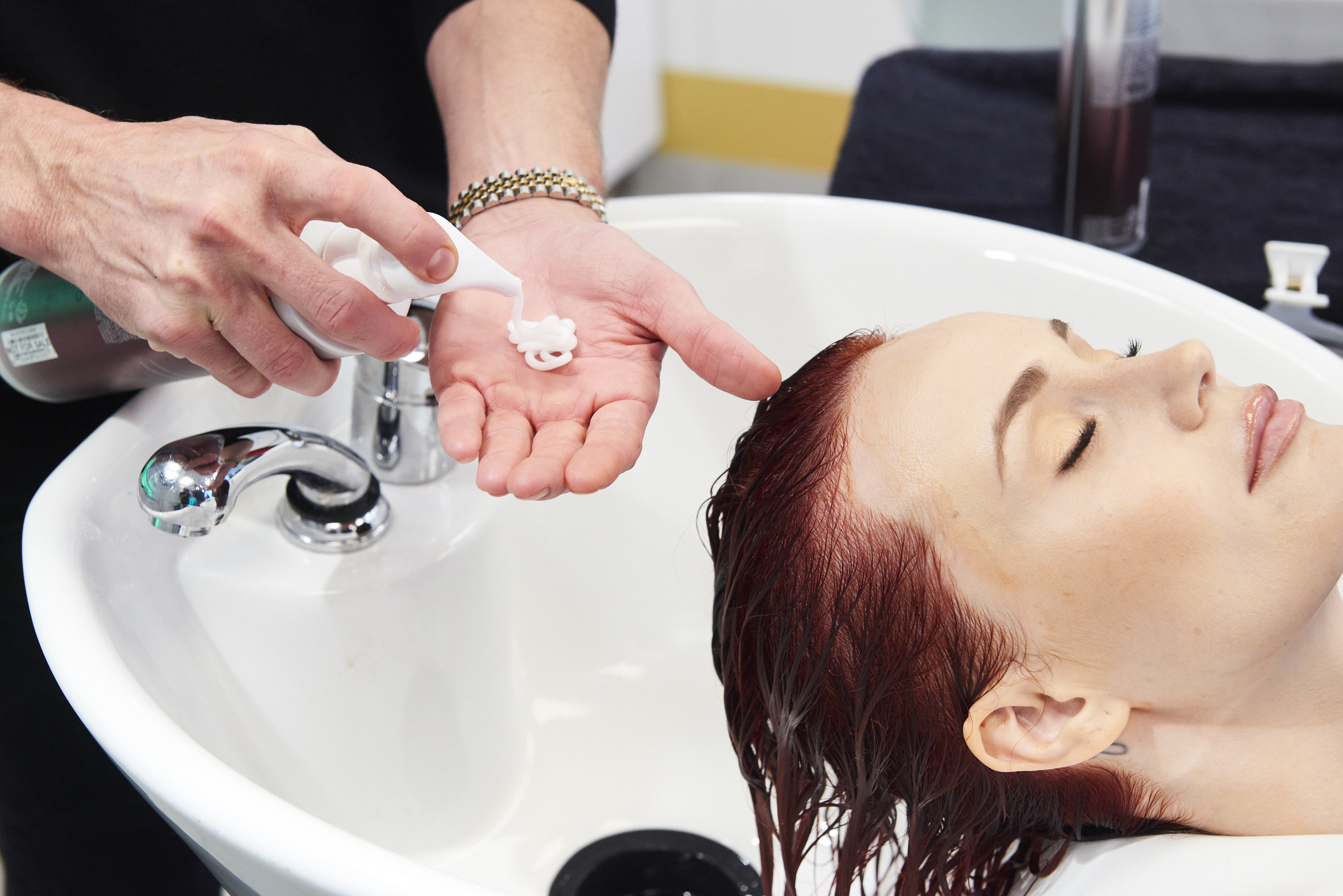 Model getting Hair Washed using Defy Damage Products